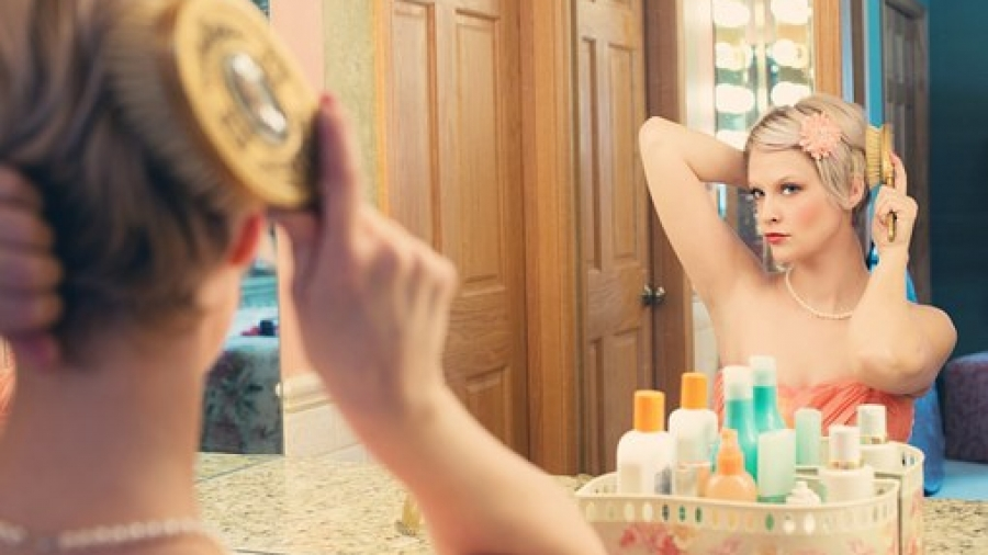Keep makeup on woman at mirror
